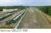 Купить «MOSCOW - JUL 28, 2015: Trains for money collection near railway tracks at summer cloudy day. Aerial view», фото № 28211199, снято 28 июля 2015 г. (c) Losevsky Pavel / Фотобанк Лори
