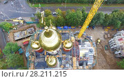 MOSCOW - SEP 09, 2015: Construction site of Holly Blessed Matrona of Moscow at autumn cloudy day. Aerial view videoframe. Редакционное фото, фотограф Losevsky Pavel / Фотобанк Лори