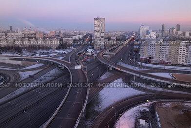 Купить «Road interchange of People Militia street, Mnevniki street and avenue Marshal Zhukov in Moscow at evening», фото № 28211247, снято 29 ноября 2015 г. (c) Losevsky Pavel / Фотобанк Лори