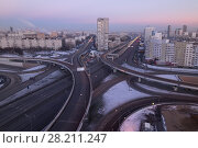 Купить «Road interchange of People Militia street, Mnevniki street and avenue Marshal Zhukov in Moscow at evening», фото № 28211247, снято 29 ноября 2015 г. (c) Losevsky Pavel / Фотобанк Лори