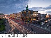 Купить «ST. PETERSBURG, RUSSIA - JUL 20, 2015: Singer building with illumination, Nevsky avenue at evening, Singer building was built in 1902-1904», фото № 28211295, снято 20 июля 2015 г. (c) Losevsky Pavel / Фотобанк Лори