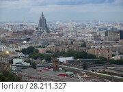 Купить «Railway station, residential buildings and roofs at summer evening in Moscow, Russia», фото № 28211327, снято 8 июля 2016 г. (c) Losevsky Pavel / Фотобанк Лори