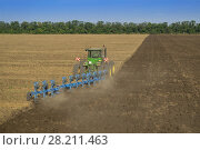 Купить «KRASNODAR REGION, RUSSIA - AUG 19, 2015: Tractor in dust plow big field, In 2015 in Krasnodar region yields reached record level - 58.4 centners per hectare», фото № 28211463, снято 19 августа 2015 г. (c) Losevsky Pavel / Фотобанк Лори