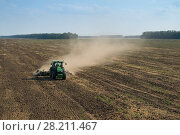 Купить «KRASNODAR REGION, RUSSIA - AUG 19, 2015: Tractor in dust plow big field, In 2015 in Krasnodar region have collected record grain harvest - 102 million tons of grain», фото № 28211467, снято 19 августа 2015 г. (c) Losevsky Pavel / Фотобанк Лори