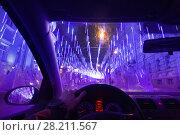 Купить «Hands of driver and windshield on street decorated with illuminations in winter night», фото № 28211567, снято 15 января 2015 г. (c) Losevsky Pavel / Фотобанк Лори