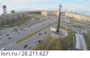 Купить «MOSCOW - APR 21, 2015: Monument of First Man in Space Yuriy Gagarin near street with city traffic at spring day. Aerial view video frame», фото № 28211627, снято 21 апреля 2015 г. (c) Losevsky Pavel / Фотобанк Лори