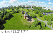 Купить «MOSCOW - JUN 06, 2015: Museum of Wooden Architecture in Kolomenskoe district during open air holiday Times and Epochs at summer sunny day. Aerial view», фото № 28211711, снято 6 июня 2015 г. (c) Losevsky Pavel / Фотобанк Лори
