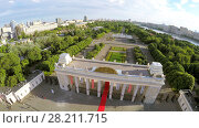 Купить «MOSCOW - JUN 11, 2015: Gate with observation area above entrance of Central Park of Culture and Rest named by M.Gorky. Aerial view videoframe», фото № 28211715, снято 11 июня 2015 г. (c) Losevsky Pavel / Фотобанк Лори