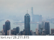 Купить «Tall Center tower on sea shore with ships in business area in mist in Hong Kong, China, view from Queen Garden», фото № 28211815, снято 4 сентября 2015 г. (c) Losevsky Pavel / Фотобанк Лори