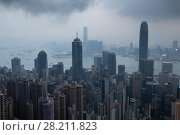 Купить «Skyscrapers, sea shore with ships, dark clouds in business area in mist in Hong Kong, China, view from Queen Garden», фото № 28211823, снято 4 сентября 2015 г. (c) Losevsky Pavel / Фотобанк Лори