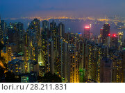 Купить «Night city with illumination in mist and sea shore in Hong Kong, China, view from Queen Garden», фото № 28211831, снято 4 сентября 2015 г. (c) Losevsky Pavel / Фотобанк Лори