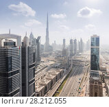 Купить «Big Highway, Emirates Grand Hotel, Burj Khalifa skyscraper in Dubai, UAE», фото № 28212055, снято 8 января 2017 г. (c) Losevsky Pavel / Фотобанк Лори