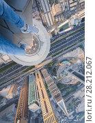 Купить «Male legs of rooftop of Millennium Plaza Hotel Dubai on Sheikh Zaid Highway, Tower, Al Yaqoub Tower, Capricorn Tower, Maze Tower, Dubai, UAE», фото № 28212067, снято 8 января 2017 г. (c) Losevsky Pavel / Фотобанк Лори