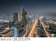 Купить «DUBAI, UAE - JAN 8, 2017: Burj Khalifa, Rose Rayhaan by Rotana, Ahmed Abdul Rahim Al Attar Tower at night, Sheikh Zayed highway», фото № 28212079, снято 8 января 2017 г. (c) Losevsky Pavel / Фотобанк Лори
