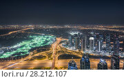 Купить «5th interchange, hotels and residential buildings at night in Dubai, UAE», фото № 28212107, снято 10 января 2017 г. (c) Losevsky Pavel / Фотобанк Лори
