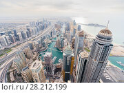 Купить «Skyscrapers in Dubai Marina area and sea shore in Dubai, UAE at sunny day», фото № 28212199, снято 15 января 2017 г. (c) Losevsky Pavel / Фотобанк Лори