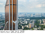 Купить «MOSCOW - JUN 26, 2014: Mercury tower of Moscow City business complex and view of dormitory area», фото № 28212259, снято 26 июня 2014 г. (c) Losevsky Pavel / Фотобанк Лори