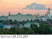 Купить «Grand Kremlin Palace, Ivan Great Bell Tower in Kremlin at sunset in Moscow, Russia», фото № 28212283, снято 26 июня 2014 г. (c) Losevsky Pavel / Фотобанк Лори