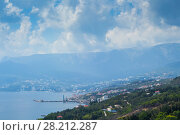 Купить «Coast of sea, resort town and green mountains at hot summer day», фото № 28212287, снято 25 августа 2013 г. (c) Losevsky Pavel / Фотобанк Лори