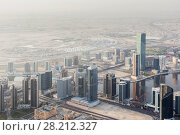 Купить «Business Bay, residential area and desert far away in Dubai, United Arab Emirates», фото № 28212327, снято 21 января 2017 г. (c) Losevsky Pavel / Фотобанк Лори