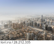 Купить «Skyscrapers in Business Bay, residential area, and desert far away in Dubai, United Arab Emirates», фото № 28212335, снято 21 января 2017 г. (c) Losevsky Pavel / Фотобанк Лори