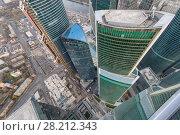 Купить «MOSCOW, RUSSIA - OCT 31, 2015: Modern skyscrapers of Moscow City business complex. Moscow International Business Center Moscow City includes 20 futuristic buildings», фото № 28212343, снято 31 октября 2015 г. (c) Losevsky Pavel / Фотобанк Лори