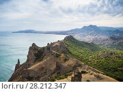 Купить «Beautiful coast of sea with rocks and mountains at hot summer day», фото № 28212347, снято 25 августа 2014 г. (c) Losevsky Pavel / Фотобанк Лори