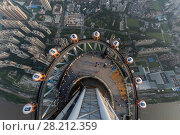 Купить «GUANGZHOU, CHINA - AUG 21, 2015: People on observation deck of Canton Tower, This is second tallest TV tower in world», фото № 28212359, снято 21 августа 2015 г. (c) Losevsky Pavel / Фотобанк Лори