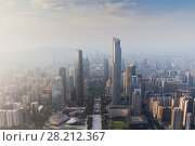 Купить «Guangzhou city in fog at sunny morning at summer day, aerial view, China», фото № 28212367, снято 21 августа 2015 г. (c) Losevsky Pavel / Фотобанк Лори