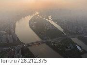 Купить «Guangzhou city, Zhujiang river among mist, China, aerial view», фото № 28212375, снято 21 августа 2015 г. (c) Losevsky Pavel / Фотобанк Лори
