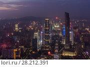 Купить «Big modern Guangzhou city with illumination in fog, China, mountains far away», фото № 28212391, снято 21 августа 2015 г. (c) Losevsky Pavel / Фотобанк Лори