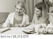 Купить «Daughter helps mother to lead home accounting», фото № 28213015, снято 13 ноября 2017 г. (c) Яков Филимонов / Фотобанк Лори