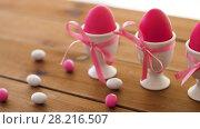 Купить «easter eggs in holders and candies on table», видеоролик № 28216507, снято 15 марта 2018 г. (c) Syda Productions / Фотобанк Лори