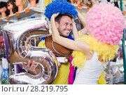 Купить «Happy yong family wearing clown wigs», фото № 28219795, снято 11 апреля 2017 г. (c) Яков Филимонов / Фотобанк Лори