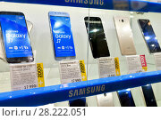 Купить «Moscow, Russia - March 17. 2018. Samsung cell phones in shop window in Trade In.», фото № 28222051, снято 17 марта 2018 г. (c) Володина Ольга / Фотобанк Лори