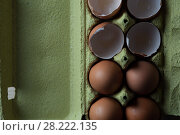 Купить «Top view - eggs cartoon box, close-up», фото № 28222135, снято 15 ноября 2017 г. (c) Pavel Biryukov / Фотобанк Лори