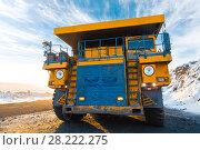 Купить «Large quarry dump truck. Loading the rock in dumper. Loading coal into body truck. Production useful minerals. Mining truck mining machinery, to transport coal from open-pit as the Coal Production.», фото № 28222275, снято 30 января 2018 г. (c) Сергей Тимофеев / Фотобанк Лори