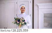 Купить «Beautiful muslim bride with make up in wedding dress with white headdress», видеоролик № 28225359, снято 24 апреля 2018 г. (c) Константин Шишкин / Фотобанк Лори