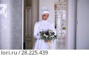 Купить «Beautiful muslim bride with make up in beautiful wedding dress», видеоролик № 28225439, снято 27 июня 2019 г. (c) Константин Шишкин / Фотобанк Лори