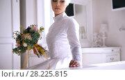 Купить «Muslim bride in white wedding dress and birdal headdress with bouquet of flowers», видеоролик № 28225815, снято 27 июня 2019 г. (c) Константин Шишкин / Фотобанк Лори