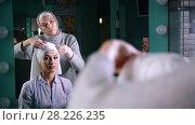 Купить «Two muslim women in front of mirror to tie Islamic turban, preparing for a wedding», видеоролик № 28226235, снято 25 апреля 2018 г. (c) Константин Шишкин / Фотобанк Лори