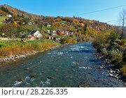 Купить «Autumn Carpathian mountain river (Ukraine).», фото № 28226335, снято 18 октября 2017 г. (c) Юрий Брыкайло / Фотобанк Лори