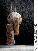 Купить «Three kinds of fresh bread in a fog of flour on a black background.», фото № 28227443, снято 21 марта 2018 г. (c) Olesya Tseytlin / Фотобанк Лори