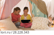 Купить «little girls with tablet pc in kids tent at home», видеоролик № 28228343, снято 23 февраля 2018 г. (c) Syda Productions / Фотобанк Лори
