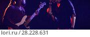 Купить «Male singer with guitarist performing at music concert», фото № 28228631, снято 16 июля 2019 г. (c) Wavebreak Media / Фотобанк Лори