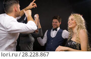 Купить «happy friends dancing at party or disco», видеоролик № 28228867, снято 7 марта 2018 г. (c) Syda Productions / Фотобанк Лори
