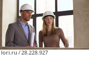 Купить «architects with blueprint and helmets at office», видеоролик № 28228927, снято 4 марта 2018 г. (c) Syda Productions / Фотобанк Лори