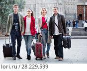 Купить «Portrait of young and mature couple with baggage», фото № 28229599, снято 19 октября 2018 г. (c) Яков Филимонов / Фотобанк Лори