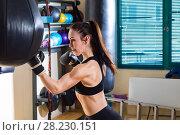 Купить «Strong woman in time of workout at boxer club», фото № 28230151, снято 21 марта 2018 г. (c) Владимир Мельников / Фотобанк Лори