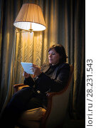 Купить «Woman Sitting in an Armchair and Using Digital Tablet and Illuminated From a Floor Lamp in Cannes In Provence-Alpes-Côte d'Azur, France», фото № 28231543, снято 22 марта 2019 г. (c) age Fotostock / Фотобанк Лори